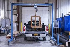 Camión de carga de grúa de pórtico fijo